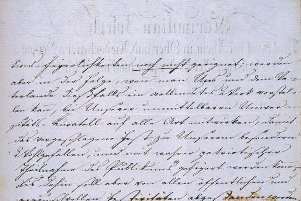Foto eines handgeschriebenen Textes auf weißen Papier